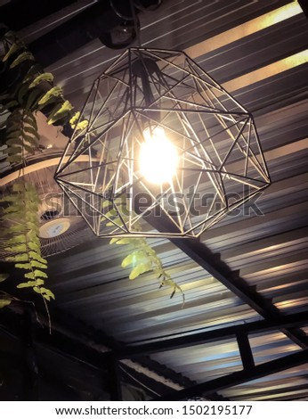 Steel cage with bulbs hanging on the ceiling. #1502195177