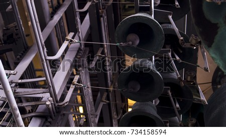 steel clockbells hanging from...