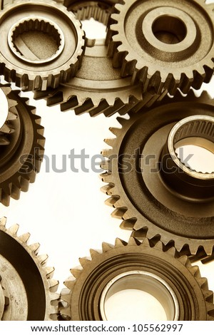 Steel cogs meshing together