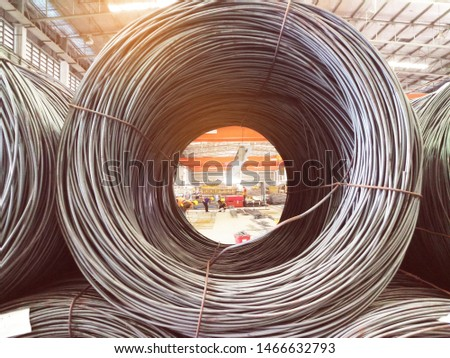 Steel coils are used as important raw materials in the plants and the construction industry. Close up metal coil.Big rolls of steel coil.