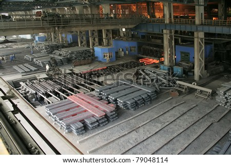 steel company production workshop in a factory, piles of steel ingot