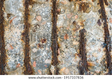 Steel corrosion in reinforced concrete. Reinforced concrete with damaged and rusty steel bar in marine and other chloride environments. Degraded concrete and corrosion of reinforcement bars ストックフォト ©