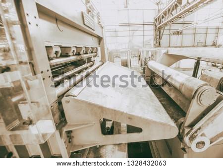 Steel Cutting Machine. Industrial machine for metel sheet coils cut, business concept. #1328432063