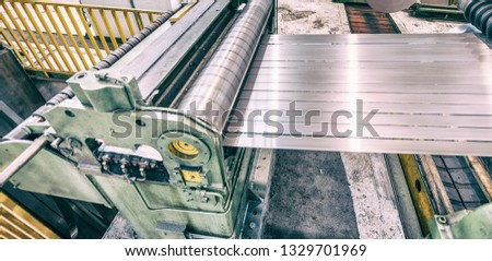 Steel Cutting Machine. Industrial machine for metel sheet coils cut, business concept. #1329701969