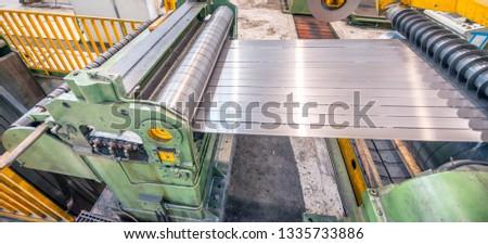 Steel Cutting Machine. Industrial machine for metel sheet coils cut, business concept. #1335733886