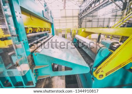 Steel Cutting Machine. Industrial machine for metel sheet coils cut, business concept. #1344910817