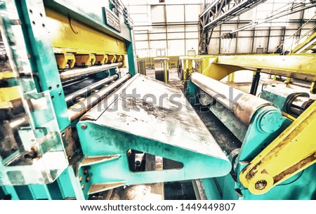 Steel Cutting Machine. Industrial machine for metel sheet coils cut, business concept. #1449449807
