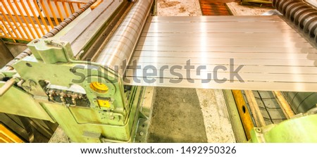 Steel Cutting Machine. Industrial machine for metel sheet coils cut, business concept. #1492950326