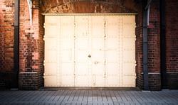 steel Door in a red brick wall background