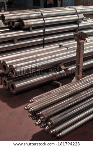 steel fabrication, metal bars stored in warehouse