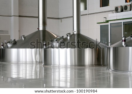 Steel fermentation vats on brewer factory