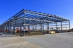 Steel frame commercial building under construction.