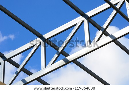 Steel frame of the factory roof in construction.