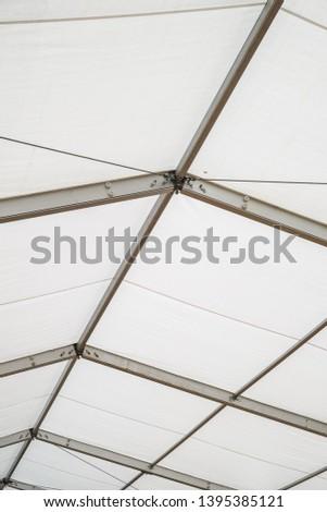 Steel frame tents Background. Inside Big Canvas Tent #1395385121