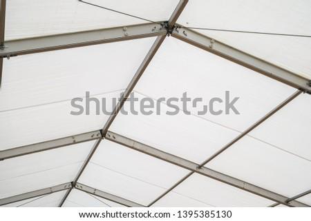 Steel frame tents Background. Inside Big Canvas Tent #1395385130