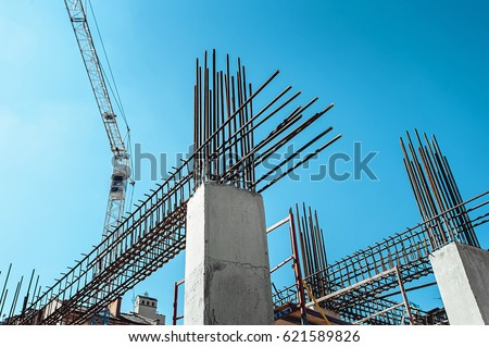 Steel Frames of A Building Under Construction, With Tower Crane On Top stock photo