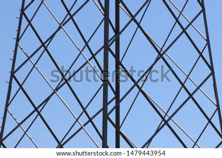 Steel framework against blue skies