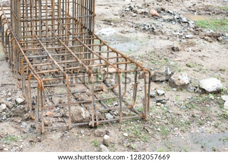 Steel framework for foundation concrete pillar in construction site.