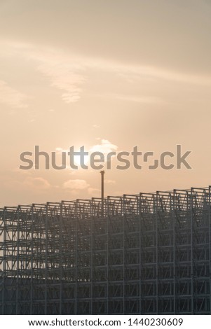 Steel framework of a building site before sunrise