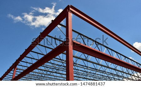 Steel framework of new commercial building in urban area.