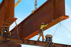 Steel girder and two meter web installed  on a bridge abutment and scaffolding as part of a new interchange in southern Saskatchewan Canada for a new freeway system and extension of the Trans-Canada