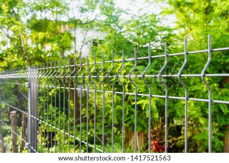 Steel grating fence made with wire. Sectional fencing installation