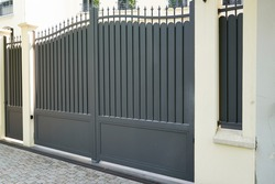 steel grey gate aluminum portal of suburb home