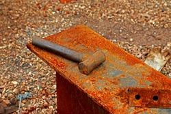 Steel hammer on rust steel plate