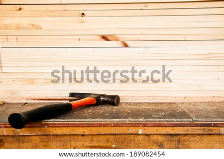 Steel Hammer with Wood Plank in Carpentry Business and Carpenter Wood Work.