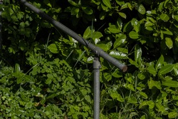 Steel hand rail on a set of steps in england with green floiage as backdrop