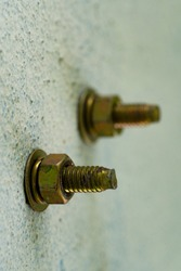 steel hex bolt and nut on the concrete wall,Construction work for connection.