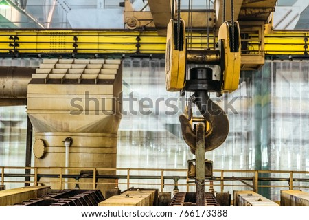 Steel hook of overhead crane over industrial equipment