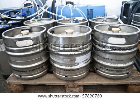 Steel industrial barrels of beer stocked in storage