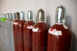 Steel Industrial Gas Cylinders. Pressurized Cylinder. Industrial stainless steel bottles in line.