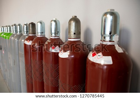 Steel Industrial Gas Cylinders. Pressurized Cylinder. Industrial stainless steel bottles in line.