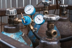 Steel Industrial Gas Cylinders Under Pressure On Construction Site, close up