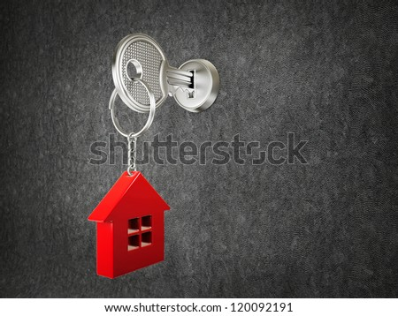 steel key and red house on a black background
