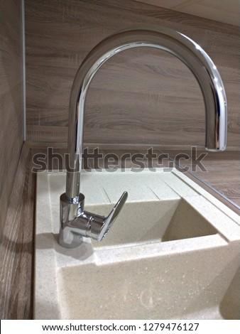 Steel kitchen faucet #1279476127