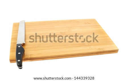 Steel kitchen knife on the wooden cutting board isolated over white background
