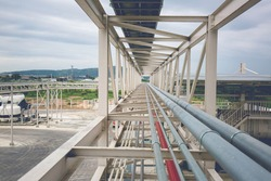 Steel long pipes rack work at high factory during refinery Petrochemical industry chemical methanol.