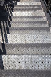 steel metal ladder made of strong metal and has an uneven structure of steps for movement and safety
