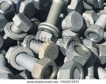 Steel nuts and screws piled in the box. Fastening construction equipment. Fixing hardware #1462611851