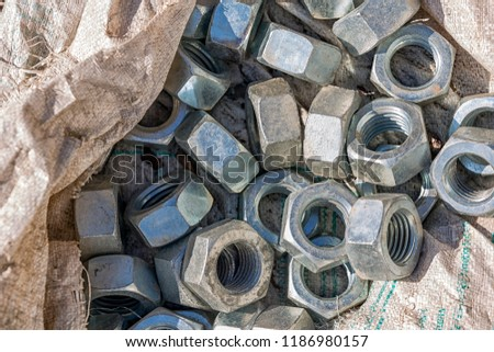 steel nuts with galvanized. A nut is a type of fastener with a threaded hole. Nuts are almost always used in conjunction with a mating bolt to fasten multiple parts together. #1186980157