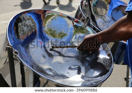 Steel pan drum player with sticks