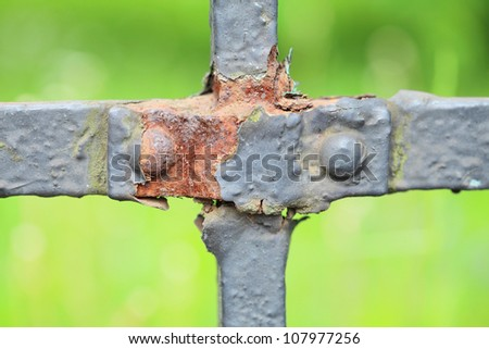 steel picket fence on green background