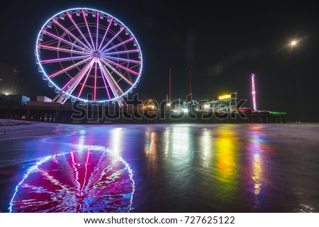 Shutterstock steel pier with reflection at night,Atlantic city,new jersey,usa.