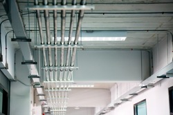 Steel pipe management for  network or electric cable with metal flex pipe or conduit.