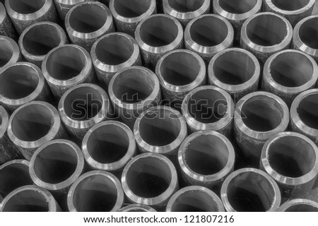 steel pipes on black and white