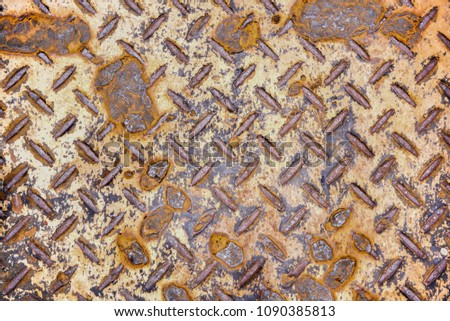 Steel plate slip old dirty metal surfaces rough. rusty sheet pattern texture background with rhombus shapes. #1090385813