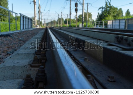Steel rail, fixed with massive bolts on reinforced concrete sleepers. Railway.  #1126730600